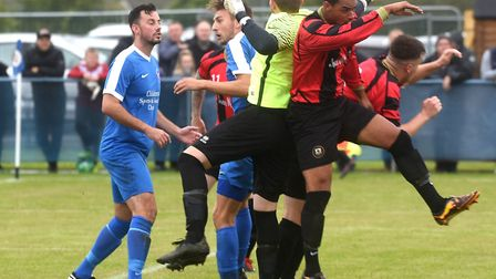 Action from the United Counties League Division clash between Whittlesey Athletic and Huntingdon Tow