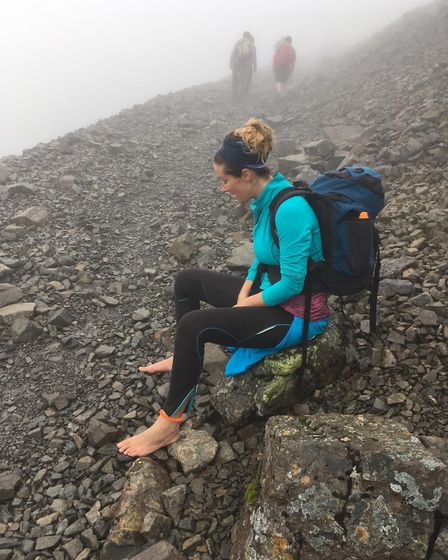 Ruth giving her feet a rest, on her way to the summit of Ben Nevis. Picture: CONTRIBUTED