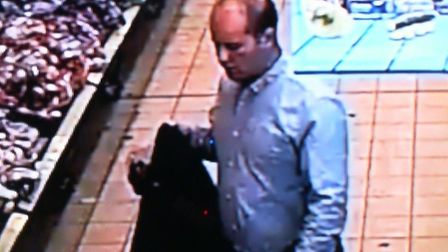 Police want to speak to him in connection with the theft of a purse from a woman's handbag at Aldi,