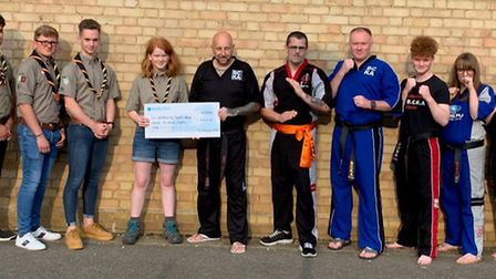 Andy Whitwell, from Whittlesey BCKA, presents the cheque to Christine Spencer in the presence of Sco