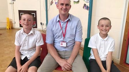 Top of the class for fundraising Soham pupils and their headteacher after they brave the shave with