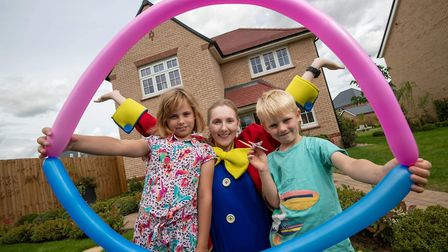 Redrow open day at the Kings Meadow Development in Ely Cambridgeshire. Froggle the clown entertains