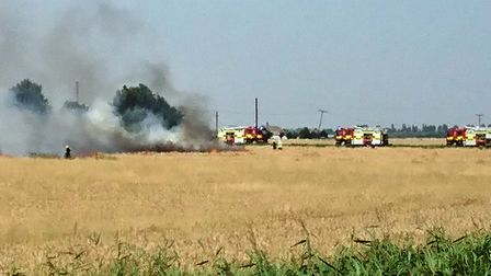 Around 60 firefighters are reportedly on scene in Pondersbridge where a large standing crop fire has