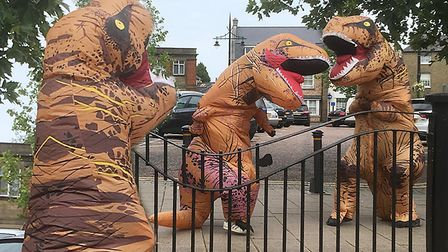 The two orange, purple and black dinosaurs spotted dancing and fighting on Marchs market place. Pict