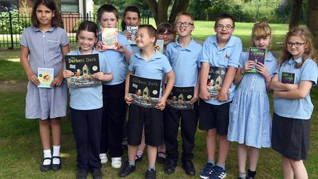 Read to Succeed 2019: Pupils with their donated books at Meadowgate School in Wisbech. Picture: IAN