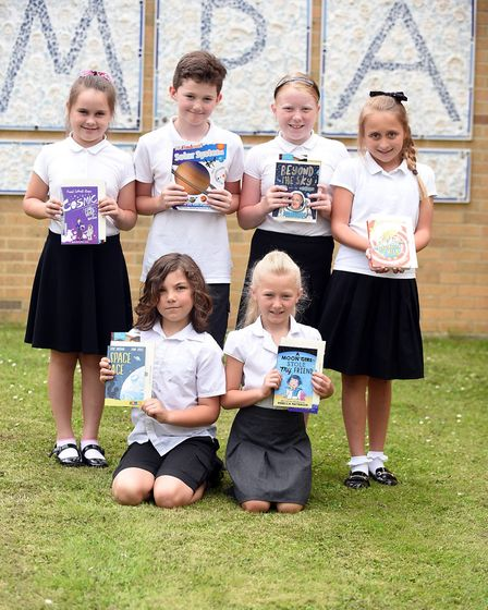 Read to Succeed 2019: Pupils with their donated books at Murrow Primary School. Picture: IAN CARTER.