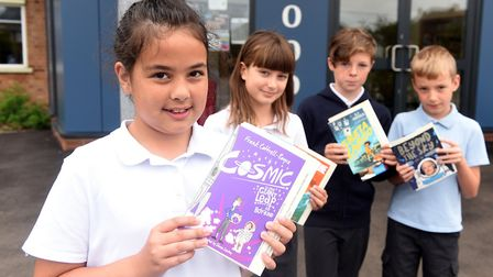 Read to Succeed 2019: Pupils with their donated books at Westwood Primary School in March. Picture: