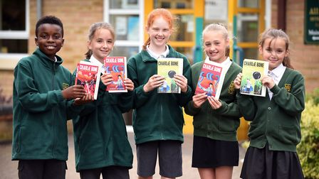 Read to Succeed 2019: Pupils with their donated books at All Saints Inter-Church Academy in March. P