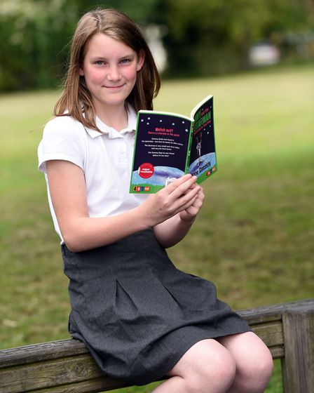 Read to Succeed 2019: Pupils with their donated books at Benwick Primary School. Picture: IAN CARTER