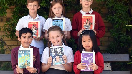 Read to Succeed 2019: Pupils with their donated books at Elm Road Primary School. Picture: IAN CARTE