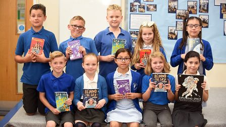 Read to Succeed 2019: Pupils with their donated books at Elm Church Oof England Primary School. Pict