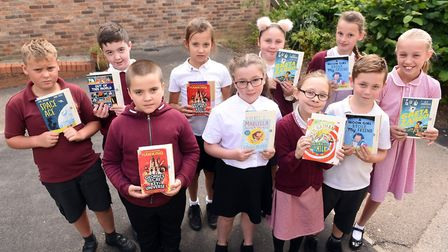 Read to Succeed 2019: Pupils with their donated books at Gorefield Primary School. Picture: IAN CART