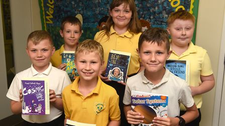 Read to Succeed 2019: Pupils with their donated books at Kinderley Community Primary School in Wisbe