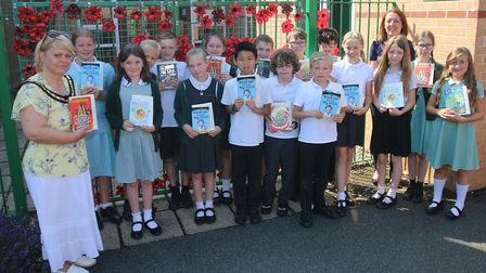 Read to Succeed 2019: Pupils with their donated books at Coates Primary School. Picture: IAN CARTER.