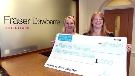 Read to Succeed 2019: Fraser Dawbarns with their cheque donation. Picture: IAN CARTER.