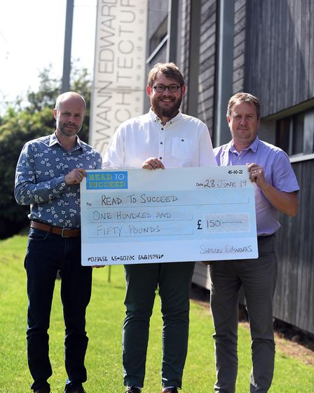 Read to Succeed 2019: Swann Edwards with their cheque donation. Picture: IAN CARTER.