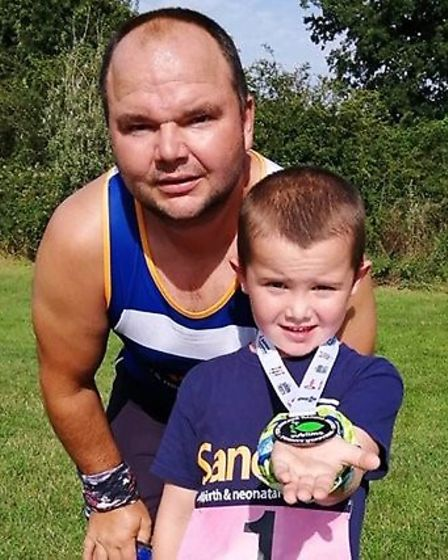 Junior TCRC member Isaac Western, 5, ran his first 1k race alongside his father Jason last week. Pic