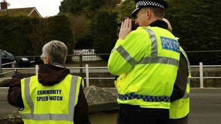 A poice officer pictured with members of the Ely Speed Watch team, who clocked 47 speeding cars. Pic
