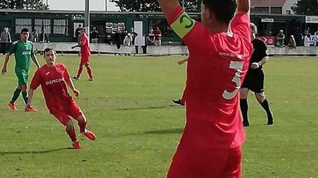 Jamie Alsop takes a throw for Ely City during their opening day victory at Gorleston in the Thurlow