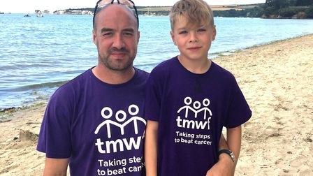 Pictured is Damien Whales and Ethan. A total of 270 people took part in the gruelling three-day Dors