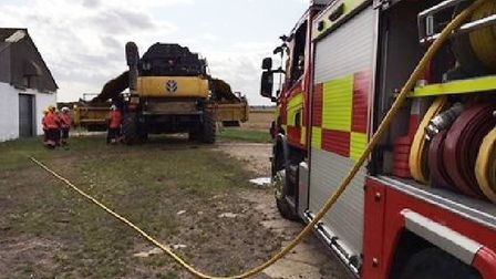 A shed fire nearly spread to fences and houses in Chatteris while a combine harvester caught fire in