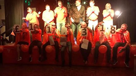 It was a night of tears and laughter as charity skydivers from a Cambridgeshire village celebrated r