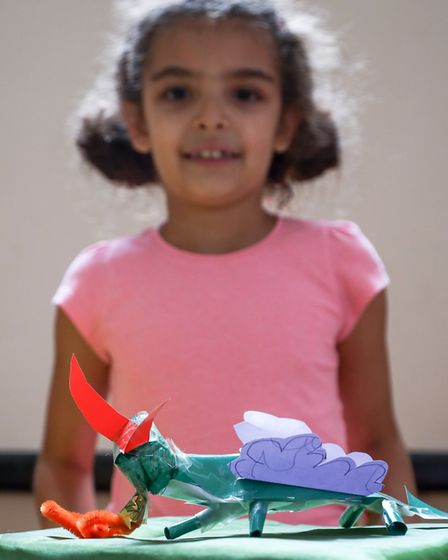 Rina Crumpler, age 6, with her winning dragon sculpture. Picture: CELIA BARTLETT PHOTOGRAPHY