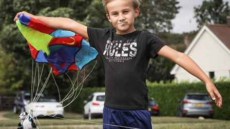 Alvie Malyon, age 8, battles with the very strong wind and his para-kite at the Quickling Festival.