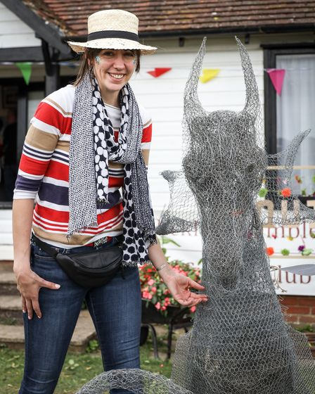 katherine Nuthall with Winstanley's Dragon, her first wire sculpture, which she had been making sinc