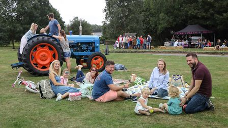 The Sullivan and Gamblen families enjoy a picnic on the green at the Quickling Festival. Picture: CE
