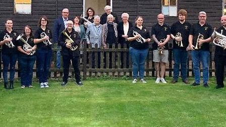 Members of Littleport Brass and their guests outside the bandroom before the ceremonial ribbon cutti