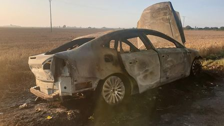 This burned out vehicle was found at Badgeny End in March this morning. Picture: SUZANNE COOKE.