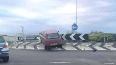 A man in his 50s has been arrested after crashing his Vauxhall Corsa car into a roundabout in March.