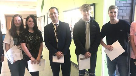 Neale-Wade Academy students pictured with their GCSE results. Picture: JASON WING/TWITTER.