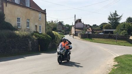 Dozens of bikers put on their leathers in scorching heat to raise more than £18,000 on a charity rid