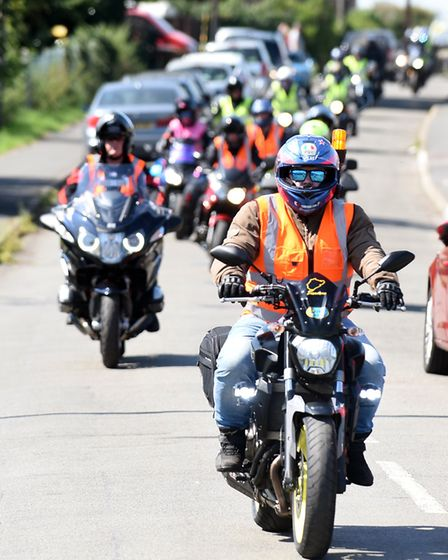 Dozens of bikers put on their leathers in scorching heat to raise more than 18,000 for a charity rid