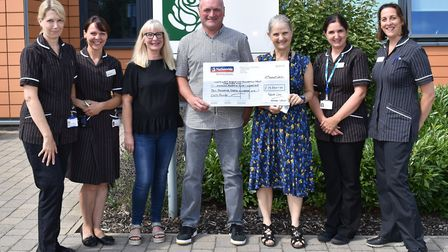 Fundraiser Mark Cross presenting the £10,000 cheque to the oncology department at Peterborough City