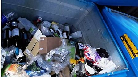 WRONG: Plastic film and sacks in the dry recycling bin. Picrture; EAST CAMBS COUN CIL
