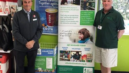 Co-op manager Paul Lewis with David Emberson, Uttlesford Foodbank driver, standing next to the new d