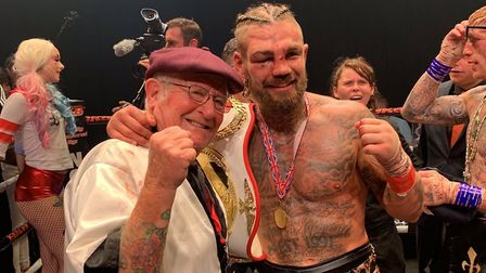 Tyler Goodjohn celebrates his world title victory with Mike Sawyer. Picture: SUBMITTED