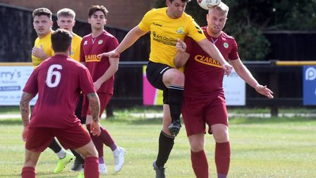 Adam Rothery battles for the ball during March Town's clash against Walsham-le-Willows in the FA Vas