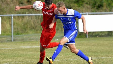 Ely City man Ash Walter uses his head in their defeat at Godmanchester Rovers. Picture: DUNCAN LAMON
