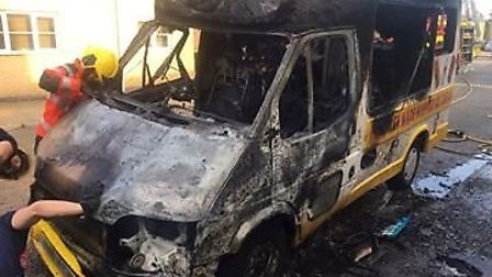 Two homes damaged after Mr Whippy ice cream van bursts into flames on residential street in Whittles