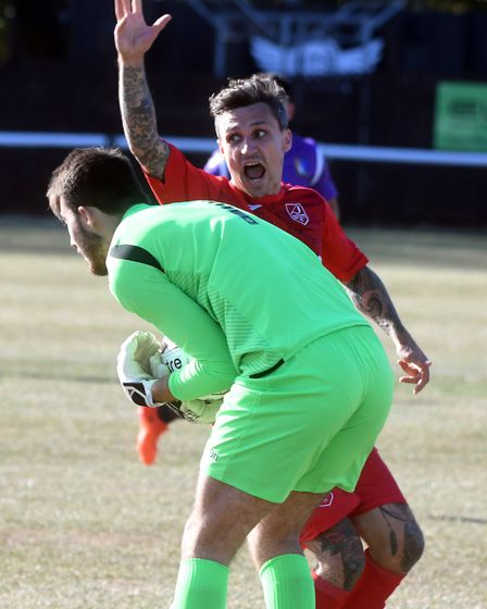 Ely City striker Sam Reed appeals as the Norwich United goalkeeper handles outside his box. Picture: