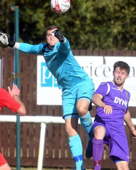 Ely City goalkeeper Harry Reynolds packing a punch against Norwich United. Picture: IAN CARTER