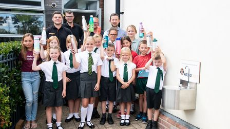 Flitch Green Academy's school parliament and members of the Great Dunmow Round Table celebrating the