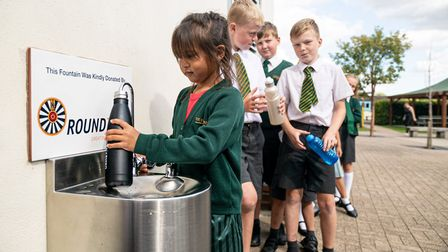 Children queing up to use the water fountain for the first time. Picture: CONTRIBUTED