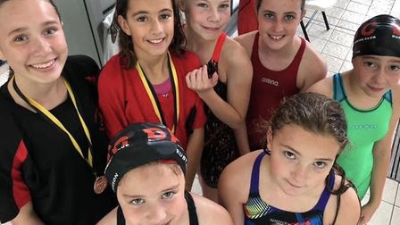 Dunmow Atlantis youngsters face the camera at the Epping Forest District meet