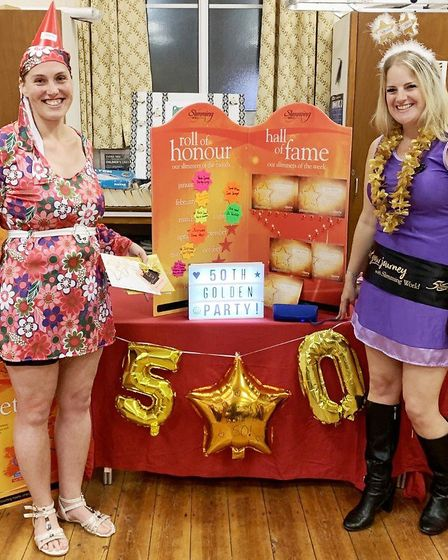 Super slimmer Kerrie Woodhead has lost more than half her body weight dazzled in a 1960s dress to ma