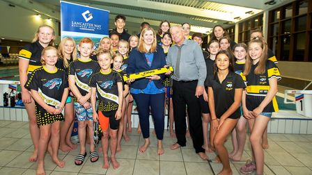 Nicola Tuck, director at Grovesmere Property Limited, along with members of Ely Swimming Club at a c